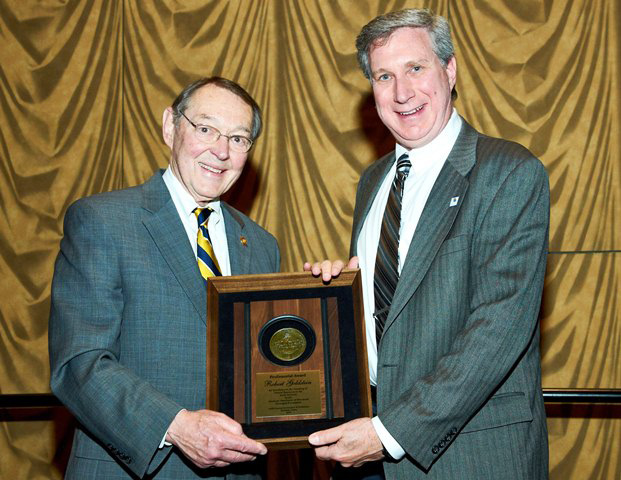 Trustee Chairman Jim Gibbs presents the 2014 Professorial Award to Dr. Robert Goldstein, Professor and Associate Dean of Mathematics and Natural Sciences at the University of Kansas.